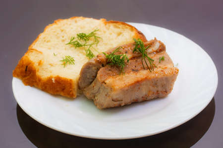 strewed: fried pork with a bread slice strewed with fennel Stock Photo