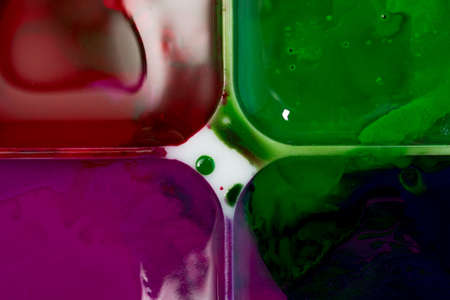 The palette of  watercolor paint. Background image. Splashes of colorful and divorces.