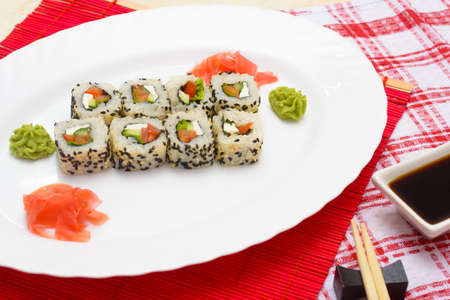 Traditional Japanese food Sushi. Closeup japanese sushi on a white plate. Sushi collection