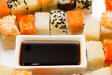 diverse set of sushi with soy sauce cup. Traditional Japanese food Stock Photo