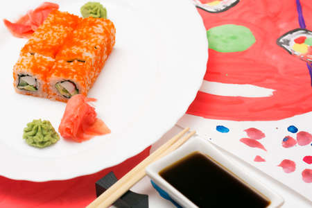 Fud art. Japanese sushi on a white plate on the tablecloth are made watercolor paint abstract image of a smiling emoticon with eyes Japanese sushi Stock Photo