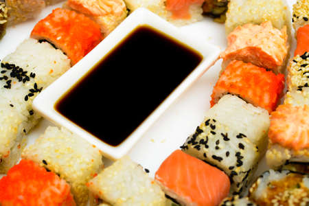 Traditional Japanese food Sushi. Closeup japanese sushi on a white plate. Stock Photo