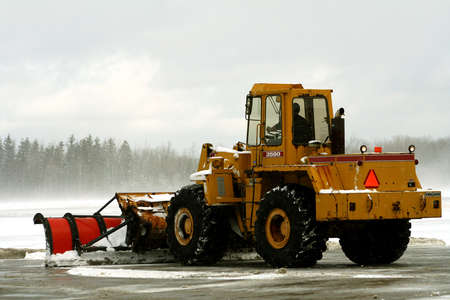 snow plow: Snow plow removing snow at airport