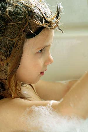 bath: Little girl taking bubble bath