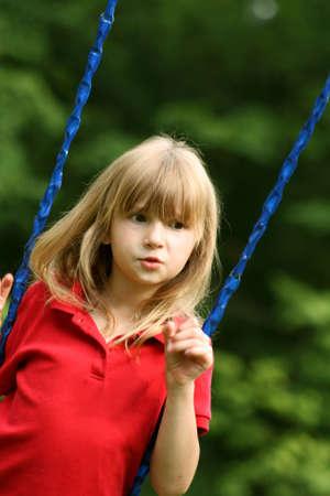 Little girl on swingset