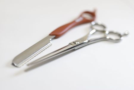 maintains: Red styling leather and cutting scissors