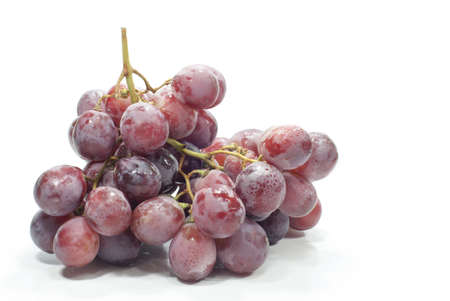 red grapes isolated on white background photo