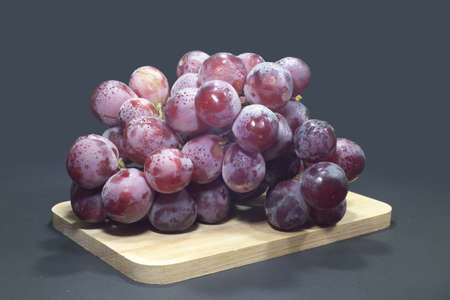 Perfect bunch of red grapes isolated photo