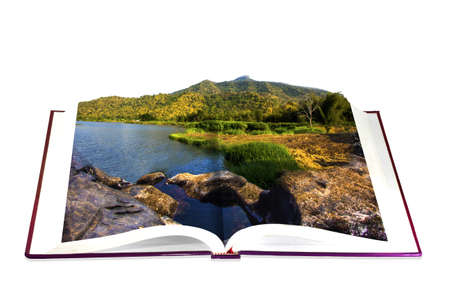 Open book  in the river. mountain and sky photo