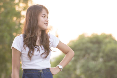 Portrait pretty woman wearing white shirts in Thailand. photo