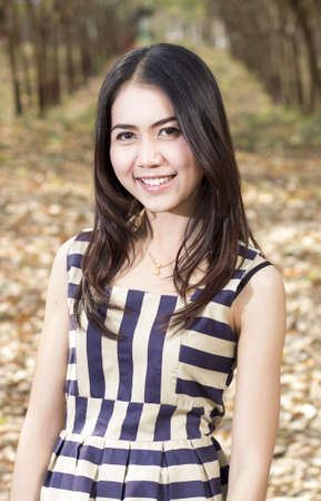 Fashion  of a  autumn girl  wearing a striped Thailand. photo