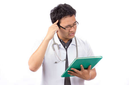 banging: A doctor banging his head realizing a mistake