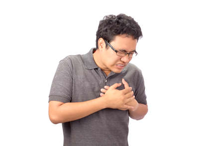 desease: man suffering chest pain on white background