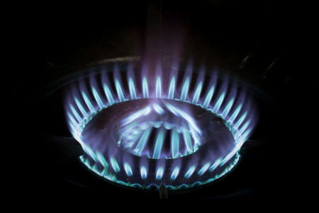 Blue flames of gas burning photo