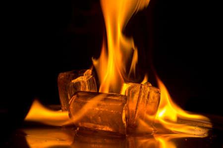Burning ice cube on  background