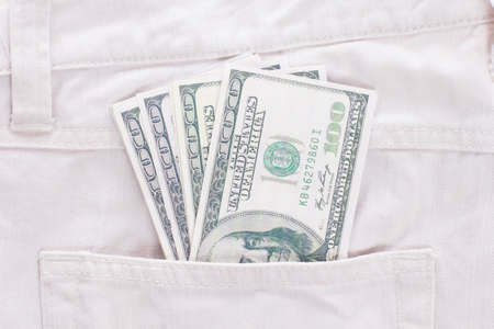 dollars in the white jeans pocket photo