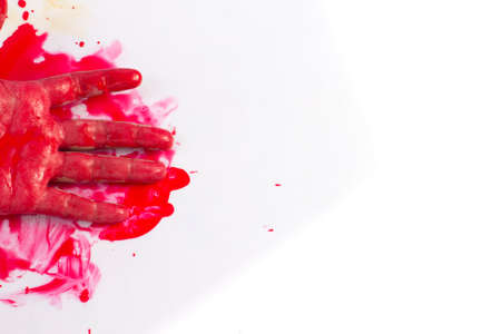 Halloween concept : bleeding hand on the white background photo