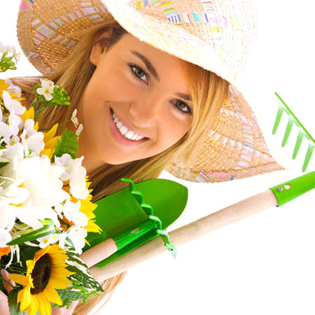 spring hat: young blond girl portrait with gardening tools