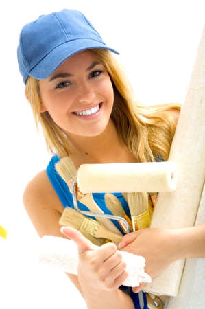 blonde girl and painting tools Stock Photo