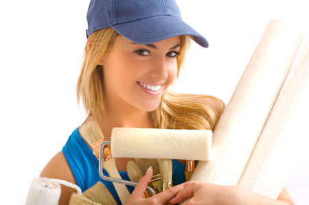 young blonde girl and painting tools Stock Photo