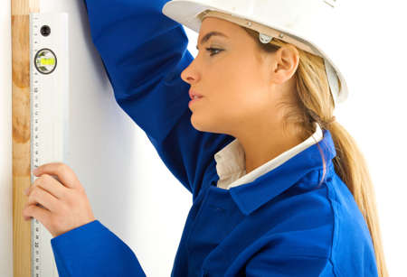 workwoman: blond girl with level Stock Photo
