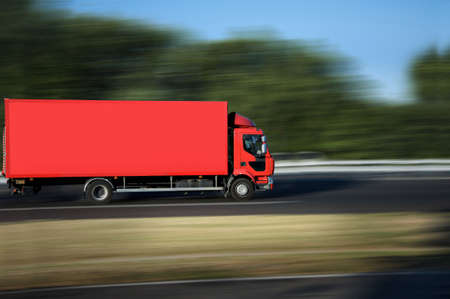 delivery driver: red truck on highway