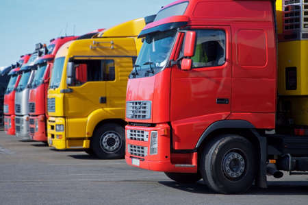 yellow and red semi trucks Stock Photo