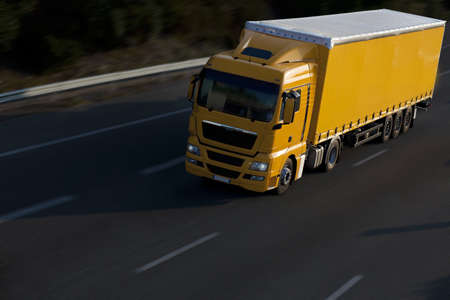 speed yellow truck with trailer Stock Photo