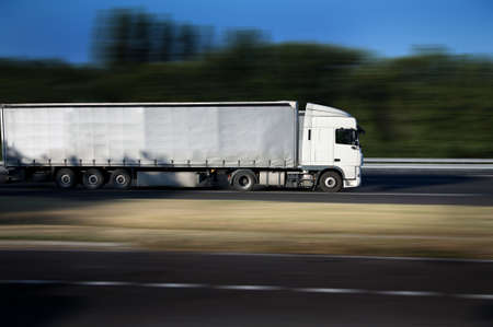 semitruck: white semi-truck on highway Stock Photo