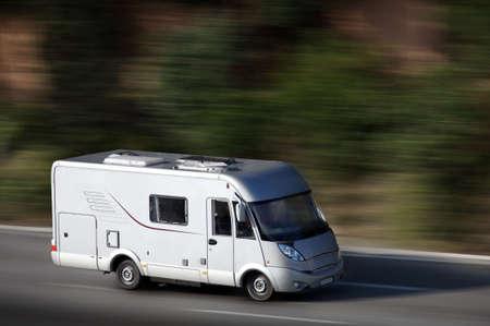camper: white van on highway