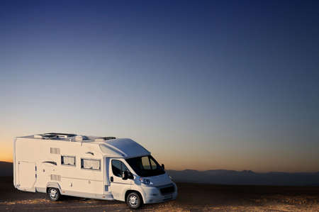 white van in desert Stock Photo