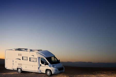 recreational vehicle: white van in desert Stock Photo