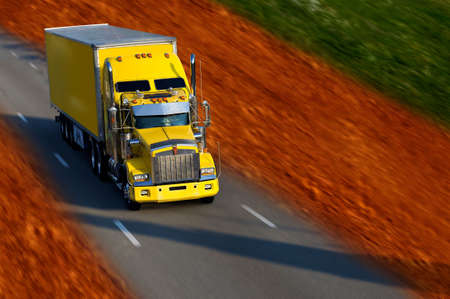 yellow semi truck in campain