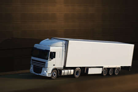 white semi truck with brown background Stock Photo