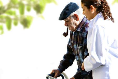 brunette medical personel helping an old man photo