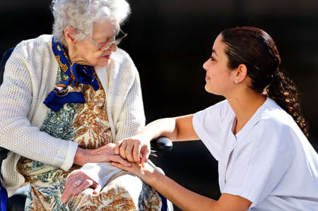 girl medical helping an old woman photo
