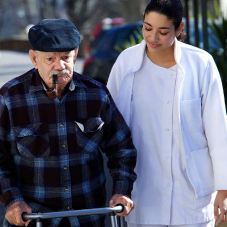 paramedical: medical personel helping an old man