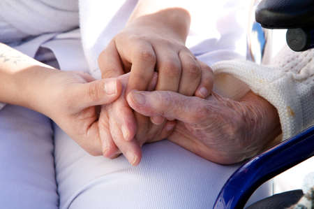 specialized: old hands with medical personel Stock Photo