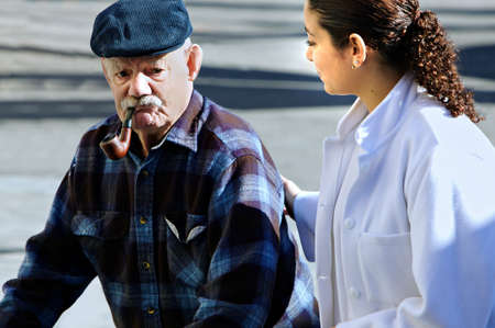 paramedical: young  personel helping an old man Stock Photo