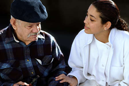 young medical personel helping an old man Stock Photo - 6961308