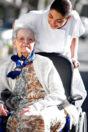 young medical personel helping an old woman photo