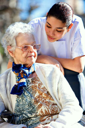 medical personel helping an old woman photo