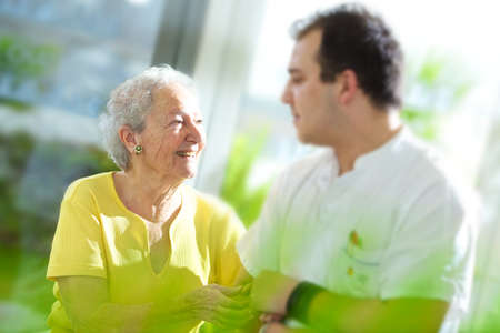 home care: medical personal with senior Stock Photo