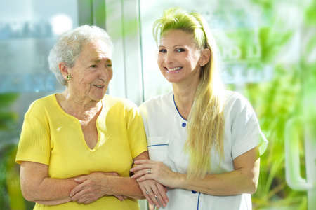 nursing homes: medical personal with senior Stock Photo