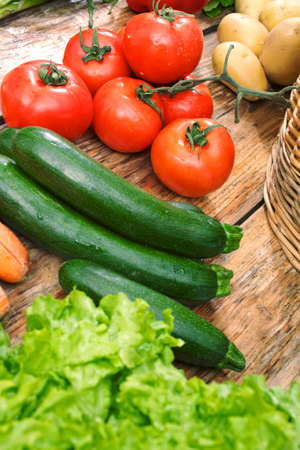 cucumber and tomato on table Stock Photo