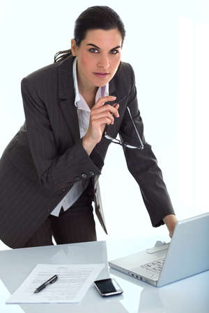 Business woman in an office with lapt