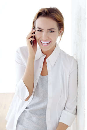 young beautiful woman with phone Stock Photo