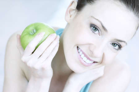 portrait of young woman with apple                                Stock Photo