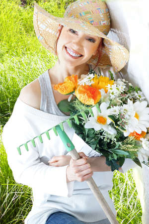 young woman with gardening tools Stock Photo - 13635400
