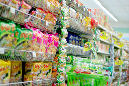 row of food in supermarket, instant noodle and dried stuffs